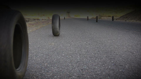Grunge Shot Of Tires Rolling Down Road stock footage