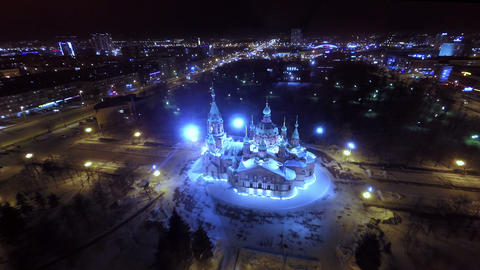 Orthodox church in the city center at night. Aeria Footage