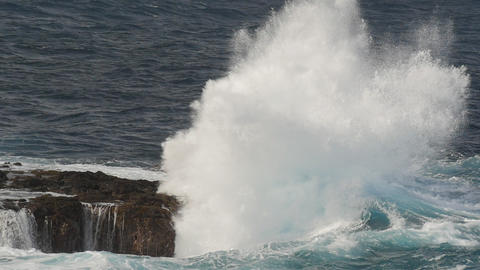 Huge slow motion waves crashing against rocks Footage