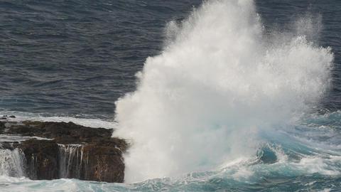 Huge slow motion waves crashing against rocks Footage