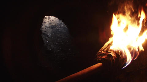 Burning Torch in a Cave Live Action