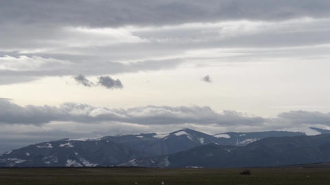 Clouds over Snowy Mountains Timelapse Footage