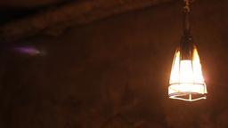 Dark Cellar Lamp Swings Footage