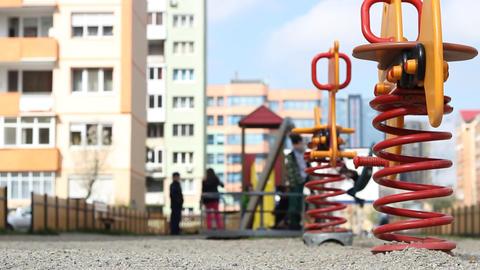 Kids Playing at Neighborhood Playground Footage