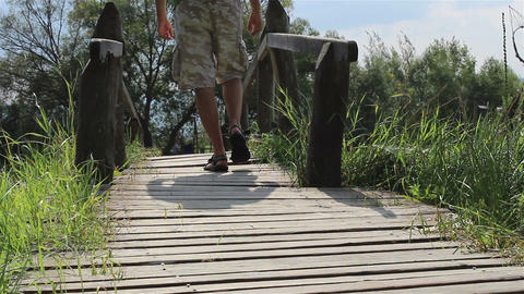 Man Steps Across a Footbridge Footage