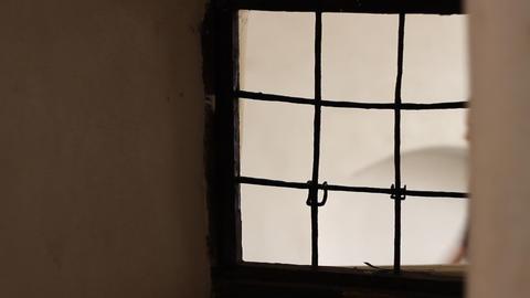 People Passing Iron Window Footage