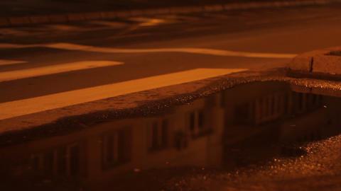 Puddle of Rain Night Traffic Footage