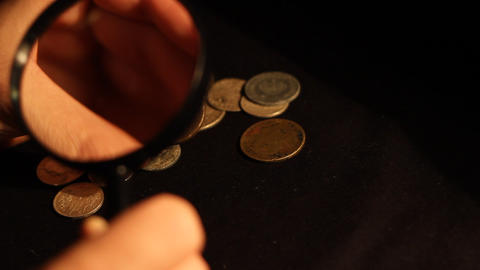 Specialist Evaluates Coins stock footage