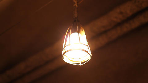 Swaying Lamp in Basement Footage