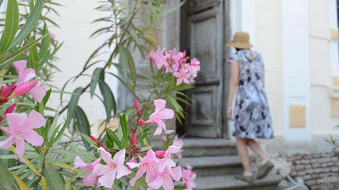 Woman Enters Old Door Footage
