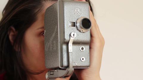 Woman Handles Vintage Camera Footage