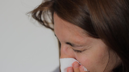 Woman is Blowing Nose Live Action