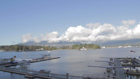 sunny day of float planes at coal harbour Vancouve Footage