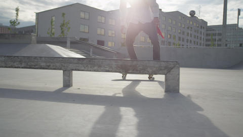 SLOW MOTION: Skateboarder riding and jumping in a  Footage