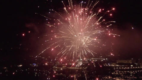 AERIAL SLOW MOTION: Fireworks above the city Footage