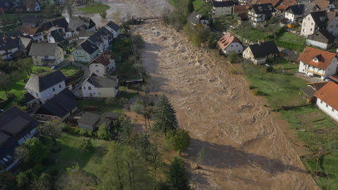 AERIAL: Big river flooding the suburbs after heavy Footage