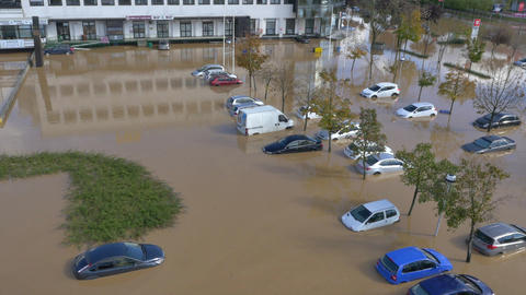 AERIAL: Cars stuck in flooded parking Footage