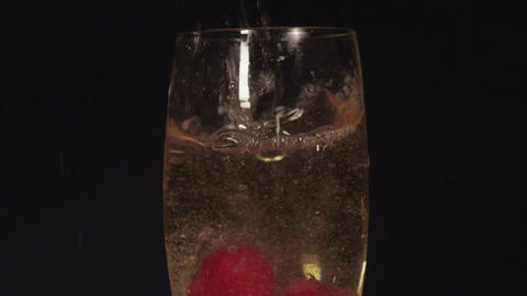SLOW MOTION CLOSE UP: Strawberries falling into th Footage