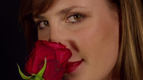 Young Woman With Red Lipstick Smelling Rose stock footage