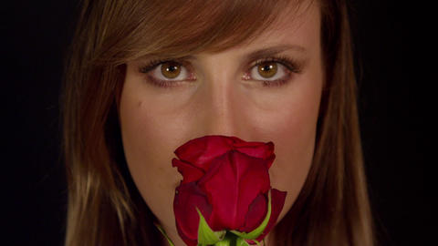 Young Woman Smells A Single Red Rose And Smiles Live Action
