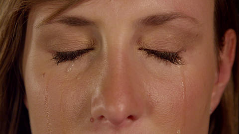 CLOSE UP SLOW MOTION: Crying woman Footage