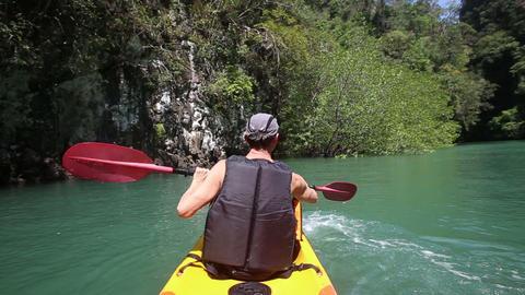 man rowing kayak and waving paddle Footage