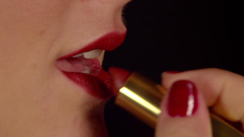 SLOW MOTION CLOSE UP: Woman Applying Red Lipstick  stock footage