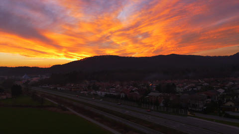 AERIAL: Amazing orange sunset above the suburban t Footage