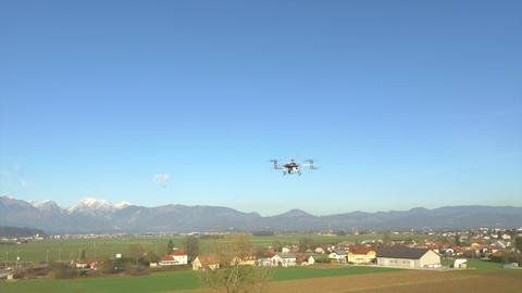 AERIAL: Drone flying above the sunny country Footage