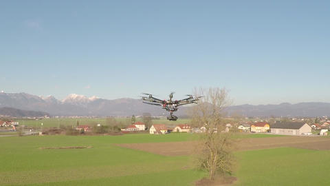 AERIAL: Professional Octocopter Flying stock footage