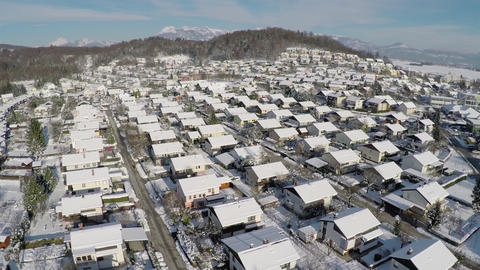AERIAL: Flying above suburban houses in winter Footage