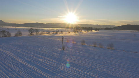 AERIAL: Snowy landscape in winter at sunrise Footage