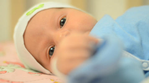 Close-up Portrait of a Beautiful Newborn Baby, Fir Footage