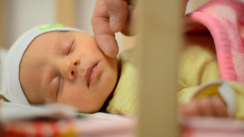 Gentle Touching Cheek of Newborn Baby, Close-up, S Live Action