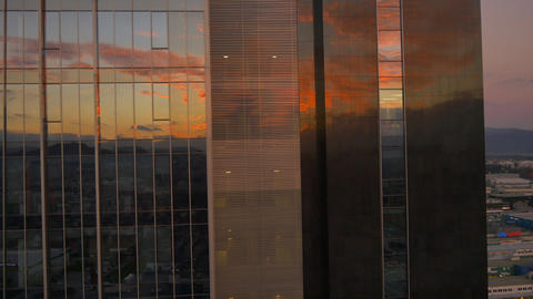 AERIAL: Sunrise reflection in big office building Footage
