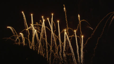 SLOW MOTION: Golden fireworks shooting up in the a Footage
