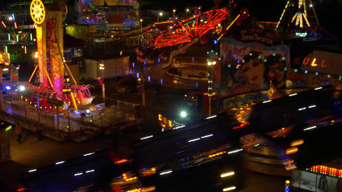 AERIAL: Luna park attractions spinning at night Footage