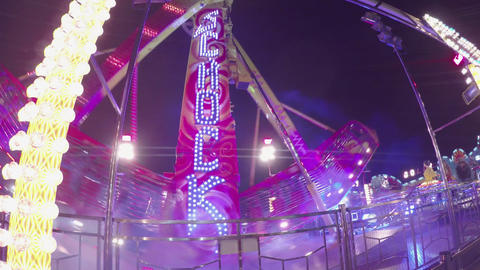 CLOSE UP: People riding a big scary attraction in  Footage