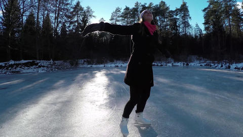 SLOW MOTION: Young woman spinning on ice skates Live Action