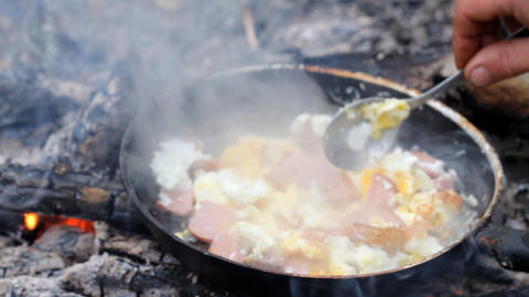 An Unusual Way Of Cooking Eggs On Fire stock footage