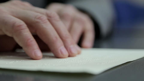 Hand Reading Braille stock footage