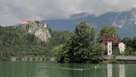 Bled Lake And Old Faiortress Surrounded By Mountai stock footage