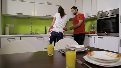 Guy And Girl In The Kitchen stock footage