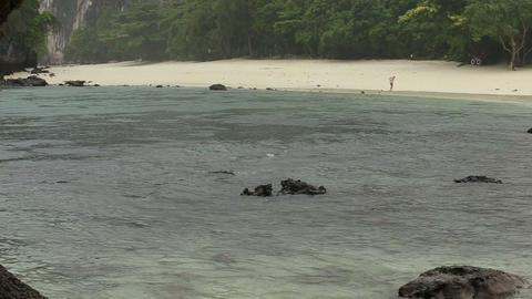 tropical rain on island beach in azure sea Footage