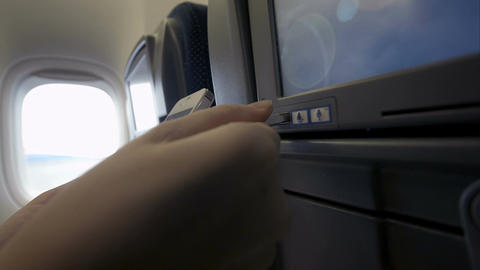 Connection Of Cell Phone And Seat Monitor In Plane stock footage