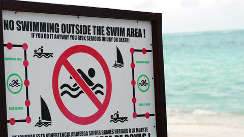 Warning board with restrictions on the beach Live Action