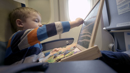 Boy in the plane drawing on board with chalk Footage