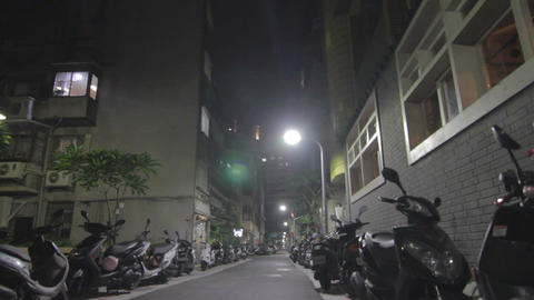 Night - Low Angle Taipei Street - Many Scooters stock footage