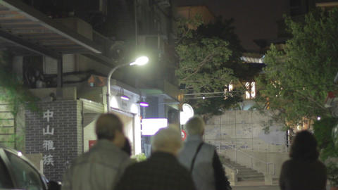 asian seniors walking in Taipei lane Footage