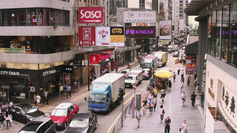View of city with shops and people walking on street in Hong Kong, China Footage